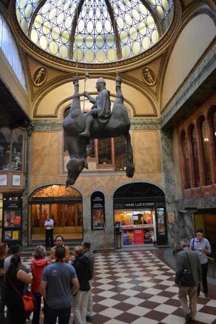 Prague artist David Cerny King Wenceslas riding a dead horse upside down near Wenceslas square - A Delicious Food Tour in Prague