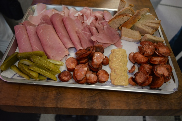 a selection of meats, mustards and pickles from the best butcher shop in the world Nase Maso - A Delicious Food Tour in Prague