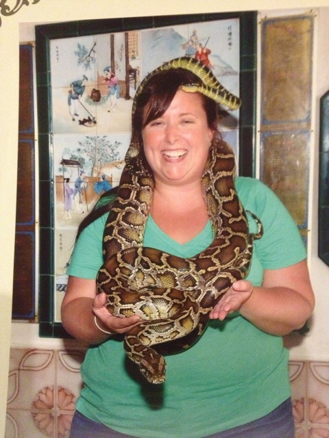 cailin holding a large python and pit viper at the snake temple - The Snake Temple in Penang, Malaysia