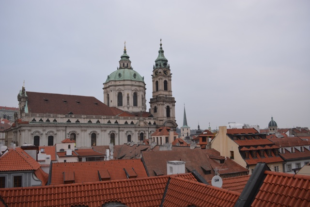 a view of Prague from the rooftop of the Aria hotel - How to Enjoy Prague Like a Local