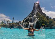 Cailin swimming in the lagoon pool at Waturi Beach in front of the krakatau volcano - Ultimate Guide to Relaxing at Universal's Volcano Bay