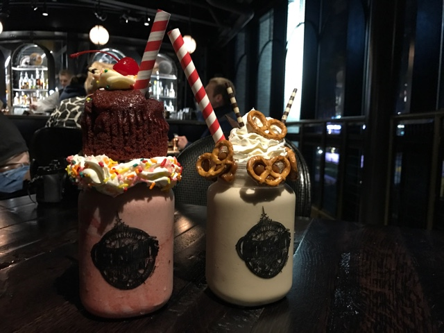 red velvet and salted dulce de leche milk shakes at The Toothsome Chocolate Emporium and Savory Feast Kitchen - The Ultimate Bucket List for Universal Orlando