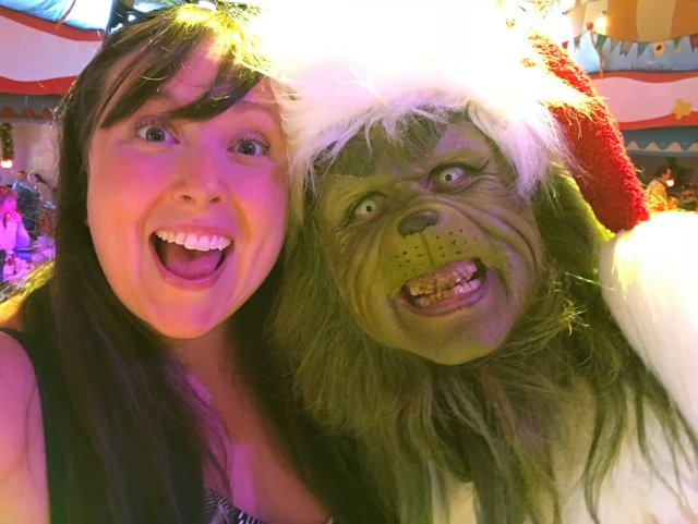 Cailin having grinchmas breakast with the grinch and whos from whoville in circus mcgurkus - Best Tips for Celebrating the Holidays at Universal Orlando