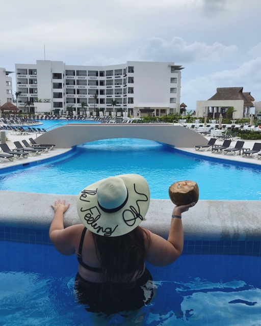 enjoying a fresh coconut in my semi private pool - Ventus at Marina El Cid Spa and Beach Resort Hotel Review