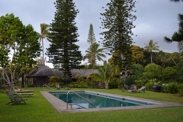 a view of the pool and main lodge at the pu'u o hoku ranch - Best Tips for Visiting Molokai, Hawaii