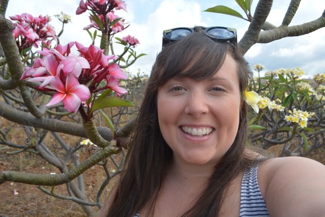 cailin visiting the molokai plumeria farm with yellow and pink plumeria - Best Tips for Visiting Molokai, Hawaii