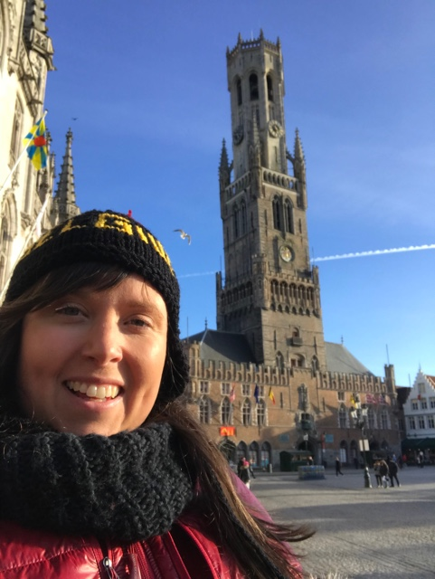 Cailin selfie with the belfry tower of bruges one of the best places to visit in bruges