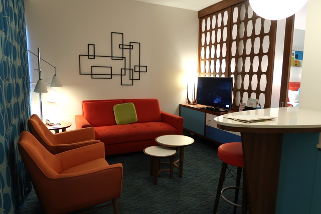 Review of Universals Cabana Bay Beach Resort - lounge with tv and pull out couch in a suite room at the cabana bay beach resort