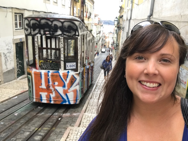what to eat in lisbon - cailin by a street car - 5 Must Try Foods in Lisbon, Portugal