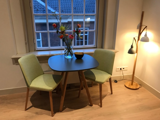 wittenberg amsterdam reviews dining table and fresh cut flowers - The Wittenberg Aparthotel Amsterdam Review