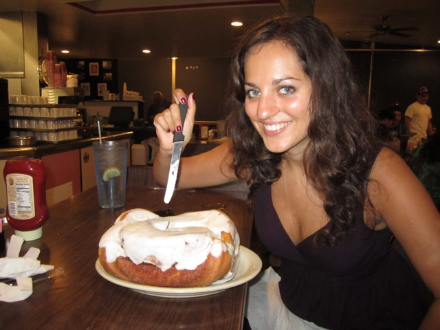 Adventurous Kate eating a three pound cinnamon roll in San Antonio Texas