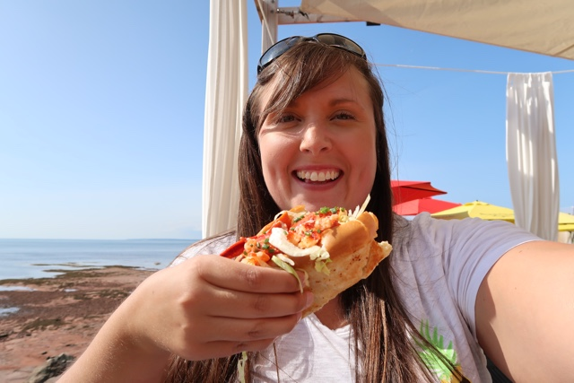 cailin eating a lobster roll at the point prim chowder house and oyster bar - Where to Eat the Best Lobster Rolls in Prince Edward Island?