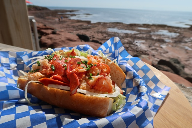 warm buttered lobster roll from the point prim chowder house and oyster bar - Where to Eat the Best Lobster Rolls in Prince Edward Island?