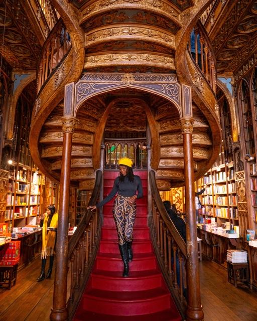 Oneika the traveller at the Livraria Lello Bookstore Porto, Portugal