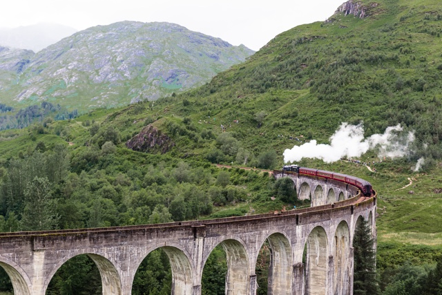 The Glenfinnan Viaduct and Jacobite Steam Train in Scotland aka hogwarts express