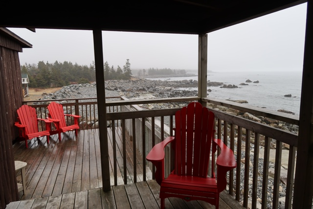 a large deck with a great view at cabin 20 - the white point beach resort