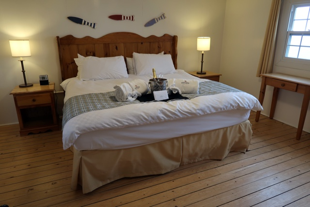 master bedroom with king bed in cabin 20 at the white point beach resort