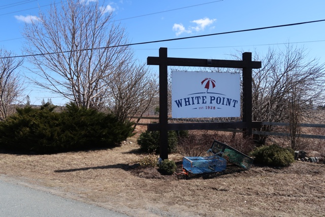 sign for the white point beach resort