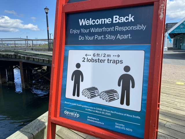 how to social distance in Halifax Nova Scotia on the waterfront with lobster traps Tips for Essential Travel During a Pandemic